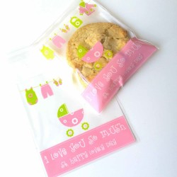 "Un sachet cadeau motif baby rose  vert et message ""I love you so mush"""